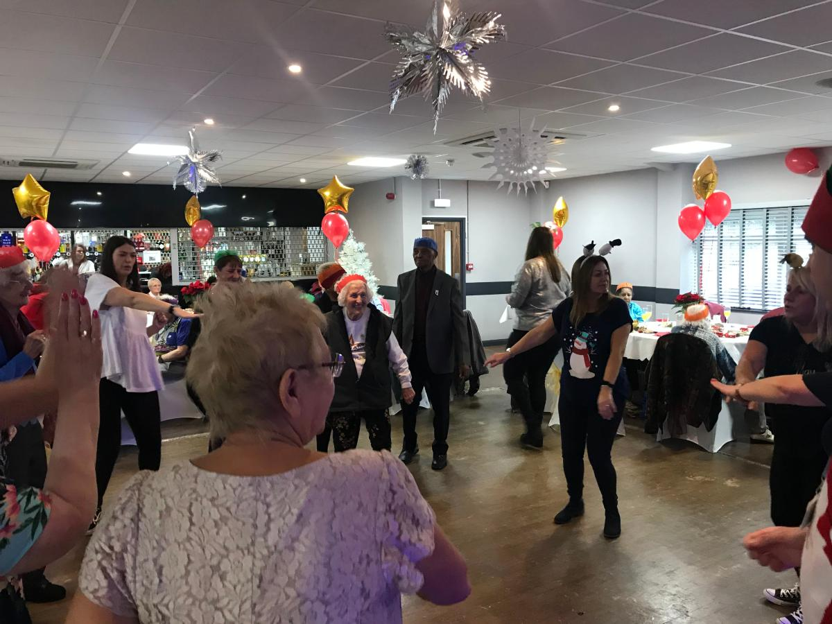 Residents and staff dancing together